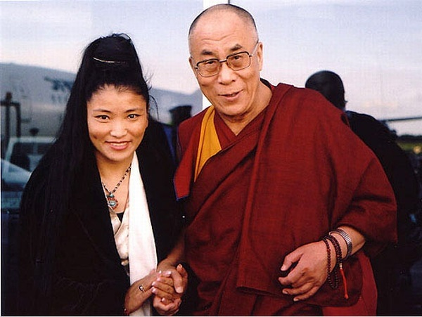 With Tibet's spiritual leader.